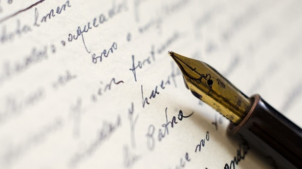 Close up of fountain pen on old letter